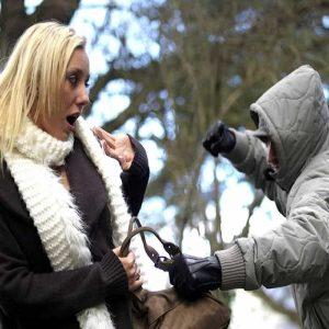 Scared woman, purse snatcher
